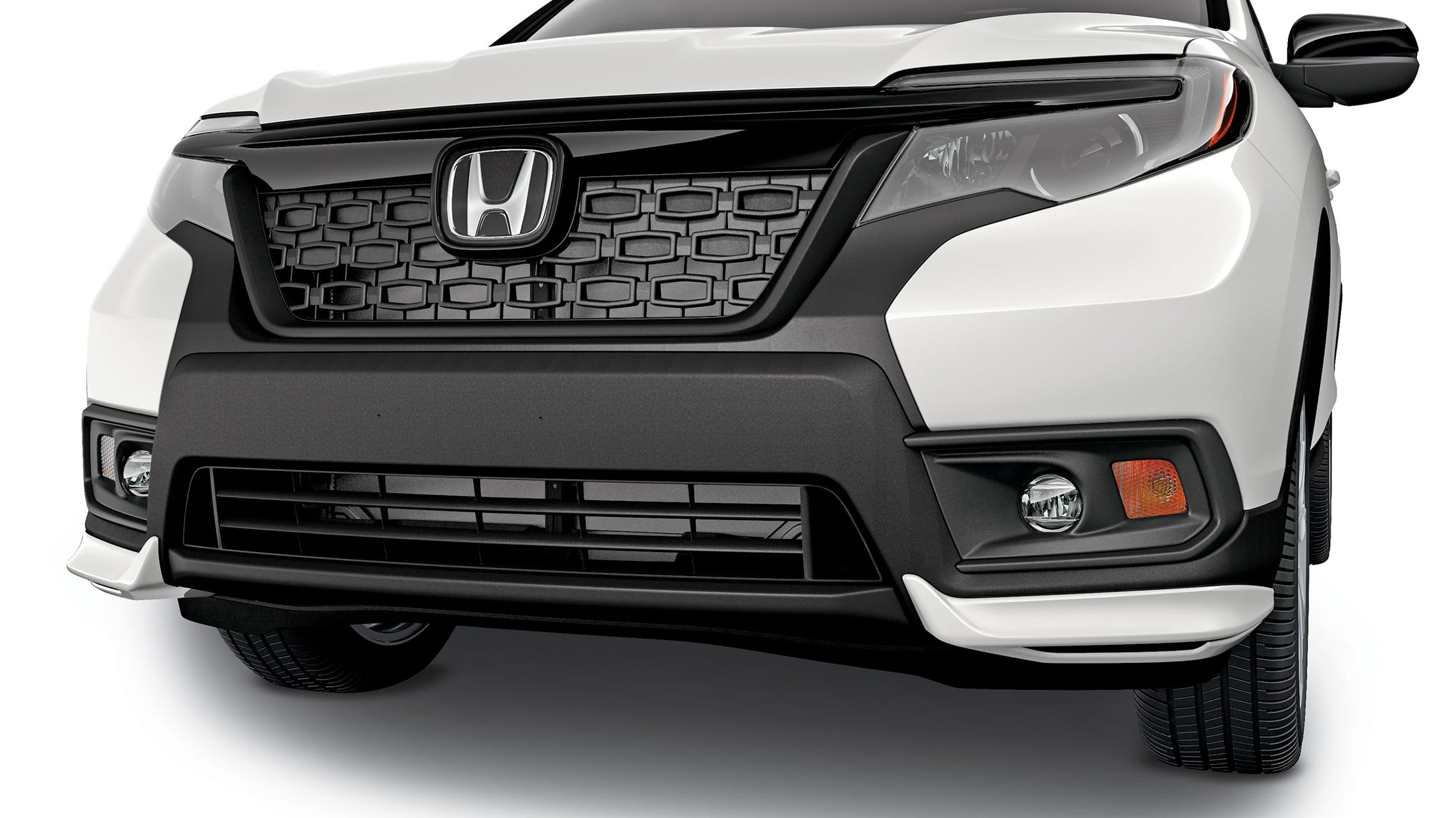 Detail of accessory front underbody spoiler on the 2019 Honda Passport.