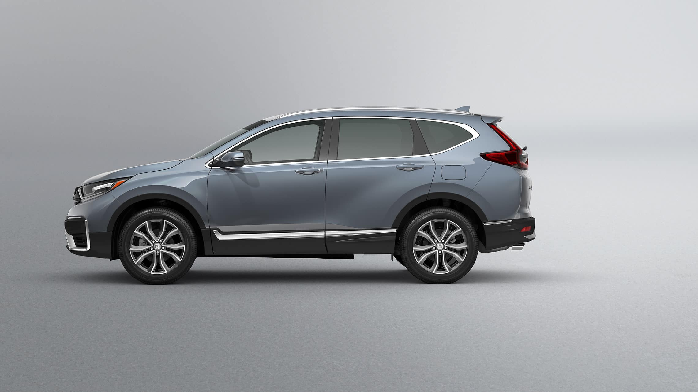 Driver-side profile view of the 2020 Honda CR-V Touring in Sonic Gray Pearl.