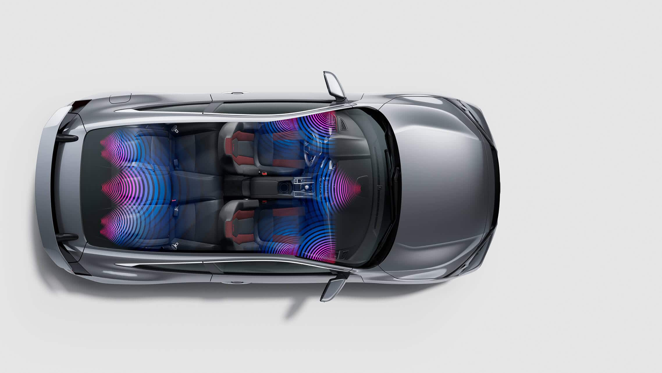 Vista aérea del Honda Civic Si Coupé2020 en Modern Steel Metallic con gráficos de sonido envolvente.