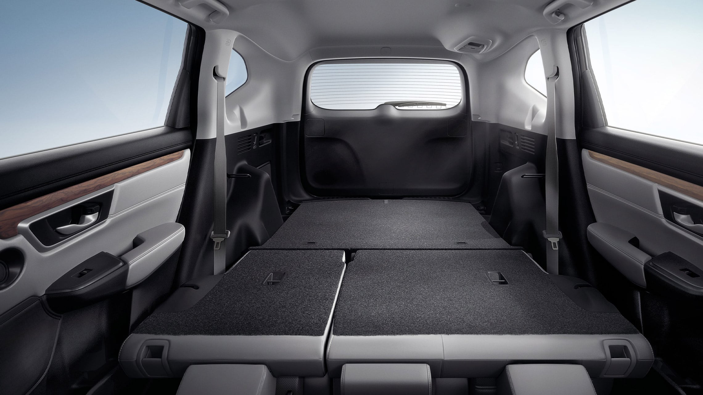 Interior view of 2021 Honda CR-V with Gray Leather demonstrating easy fold-down 60/40 split rear seatback.