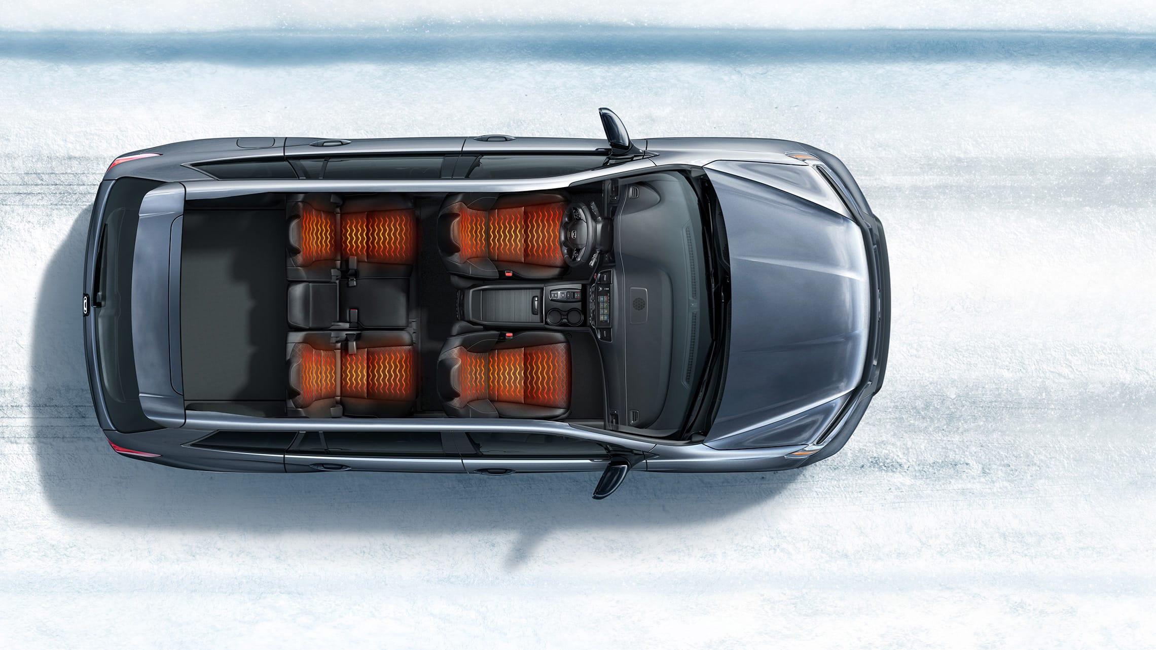 Vista aérea de la Honda Passport Elite2021 que muestra asientos calefaccionados en un entorno de caminos nevados.