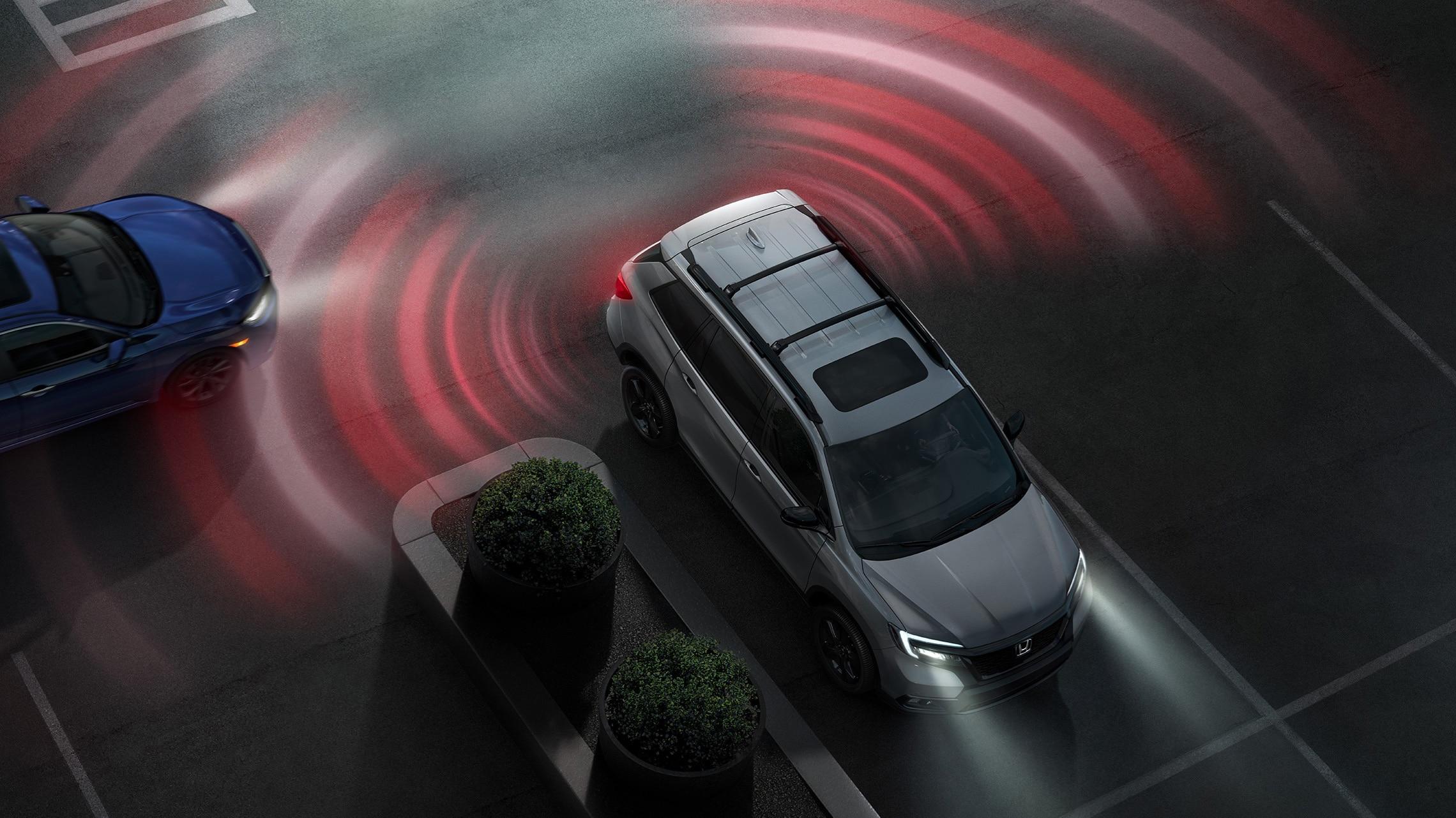 Vista aérea de la Honda Passport Elite2021 en Modern Steel Metallic que muestra el sistema de monitor de tránsito cruzado.